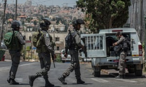 Israeli border police stand guard near the At-Tur junction, East Jerusalem, last Wednesday.