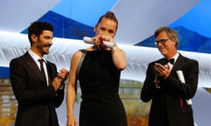 French actress Emmanuelle Bercot (C) poses on stage with French actor and member of the Un Certain Regard jury Tahar Rahim (L) and US director Todd Haynes after being awarded with the Best Actress prize during the closing ceremony of the 68th Cannes Film Festival in Cannes, southeastern France, on May 24, 2015.        AFP PHOTO / VALERY HACHEVALERY HACHE/AFP/Getty Images.