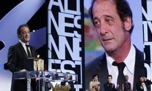 Actor Vincent Lindon stands on stage after receiving the Best Actor award for the film The Measure of a Man during the awards ceremony at the 68th international film festival, Cannes, southern France, Sunday, May 24, 2015. (AP Photo/Lionel Cironneau).