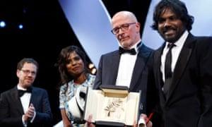 Jacques Audiard with the stars of Dheepan, Kalieaswari Srinivasan and Jesuthasan Antonythasan, and joint jury chair Ethan Coen.