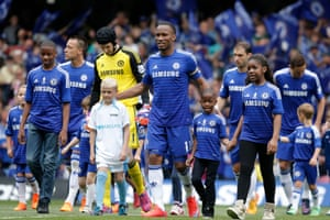 The club honour Didier Drogba's service by making him captain for the day and he leads his team out