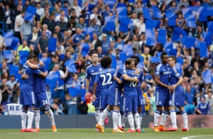 The Chelsea players congratulate each other ahead of kick-off