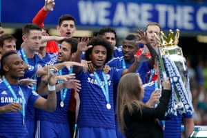 The Premier League trophy is passed to John Terry as he team-mates get ready to celebrate