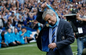 Jose Mourinho takes off his winners medal ...