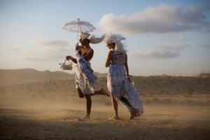 Festival goers in costume walking during the Israel Midburn festival in the Negev desert southern Israel