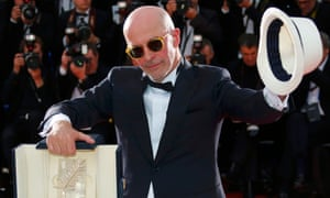 """Director Jacques Audiard, Palme d'Or award winner for his film """"Dheepan"""", poses after the closing ceremony of the 68th Cannes Film Festival in Cannes."""