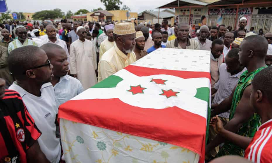 Men carry the coffin of Zedi Feruzi, during his funeral, in Bujumbura. He and one of his bodyguards were killed in a drive-by shooting.