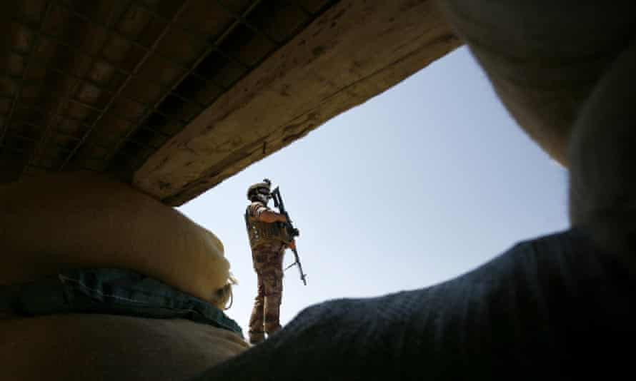 An Iraqi soldier in the Jurf al-Sakher area, some 50 kilometres south of Baghdad, to protect the region from further Isis gains following the fall of Ramadi.