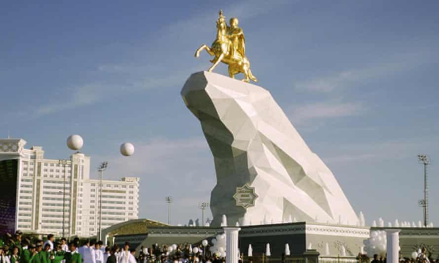 People gather in Ashgabat, Turkmenistan, on Monday for the inauguration of a monument to President Gurbanguly Berdymukhamedov