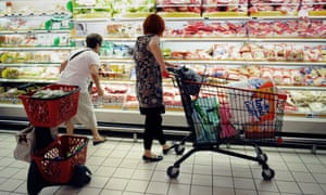 People shop in a supermarket in southern France.