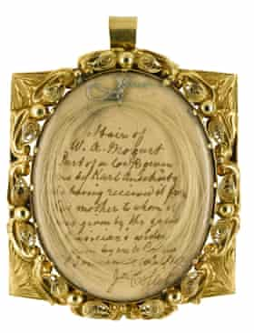 The lock of hair being sold in a gold locket.