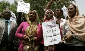 """Sudanese journalists hold banners that read """"press freedom or no press"""" as they protest over the suspension of al-Tayar daily in Khartoum in July 2012."""