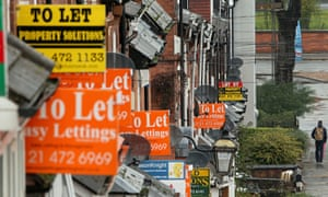 o Let and For Sale signs protrude from houses in the Selly Oak area of Birmingham