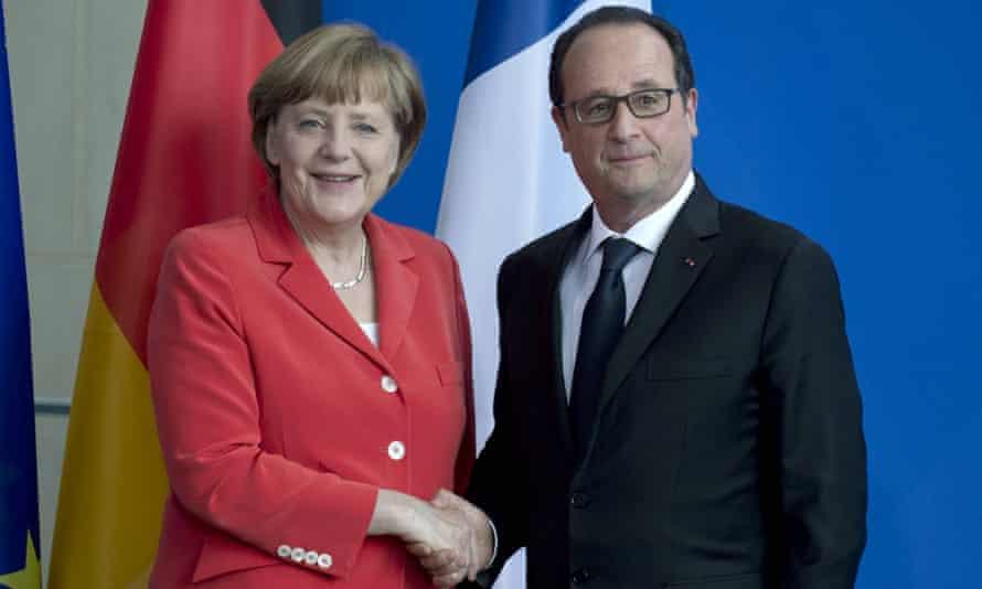 Angela Merkel and François Hollande shake hands in Berlin.
