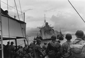 <strong>January 1944 </strong>American soldiers approach the Queen Mary, which served as a troop ship during the second world war. It often carried around 15,000 men a voyage.
