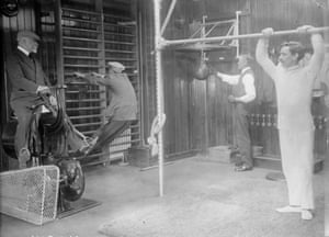 <strong> June 1912 </strong>Passengers working out in the gym of the RMS Franconia, which was destroyed by a U-boat in 1916. Among the equipment is a punchbag and early version of an exercise bicycle.