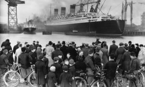 <strong> March 1936</strong> A crowd admires the nearly completed Queen Mary at Clydebank near Glasgow. It was built with a loan from the government in 1934, granted on condition that Cunard merge with the White Star Line.