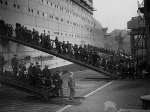 <strong>January 1935 </strong> Some of the hundreds of workers employed on the construction of the RMS Queen Mary at John Brown's shipyard, Clydebank, leaving the vessel at lunchtime.