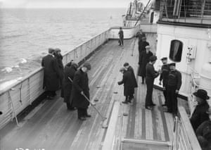 <strong> June 1912 </strong> Saloon passengers enjoy a game of shuffleboard on the deck of the RMS Lusitania. It was torpedoed and sunk by a German U-boat on 7 May 1915.