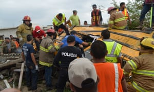 Firefighters inspect the wreckage of a bus in Ciudad Acuna.