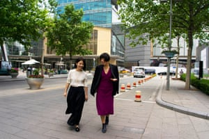 Cheung walks with her personal assistant.
