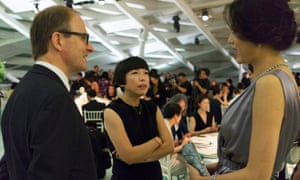 Cheung talks to a Chinese fashion model at a Tiffany launch event in Beijing.