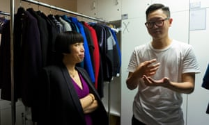 Cheung is shown a forthcoming collection of clothes by Chinese designer Davidson Tsui.