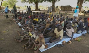Former child soldiers wait to be released in Bambari, Central African Republic, in May as part of a UN-brokered deal.