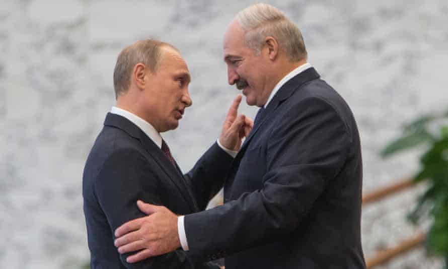 Belarus's president Alexander Lukashenko, right, greets his Russian counterpart Vladimir Putin during a leaders' summit in 2014.