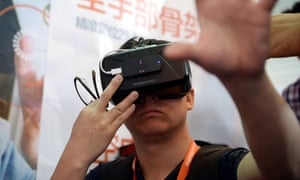 A visitor tries the Oculus Rift Development Kit 2 at the first Consumer Electronics Show in Asia, in Shanghai on Tuesday.
