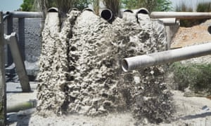 Water laden with ash from ANPARA Power Ltd tis discharged into the Rihand river dam at Bichachi village.