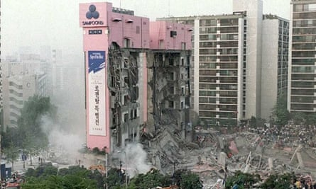 The remains of the Sampoong Department store on the 29 June 1995 just hours after it collapsed, when air conditioning units on the roof crashed through to the top floor.