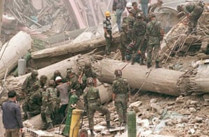 US military troops and South Korean army soldiers look for survivors in the rubble. 502 people died, and almost 1,000 were injured in the collapse.