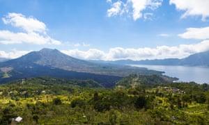 07 May 2013, Bali, Indonesia --- Indonesia, View of volcanic mount Batur with volcanic lake --- Image by   Martin Moxter/Westend61/CorbisAsiaBaliBangli Regencybeautybeauty in naturecloudscratercrater lakeIndonesiaislandlandscapelightlushMalay ArchipelagoMount BaturmountainnobodyNusa TenggaraoutdoorsscenicserenityskySoutheast AsiaSunda Islandssunshinetravelvolcanic featurevolcanic landscapevolcanowaters