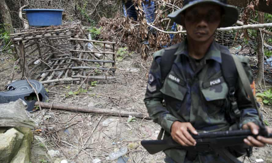 A cage made of barbed wire and bamboo sticks that Malaysian police said was used to hold migrants is seen at the abandoned camp.