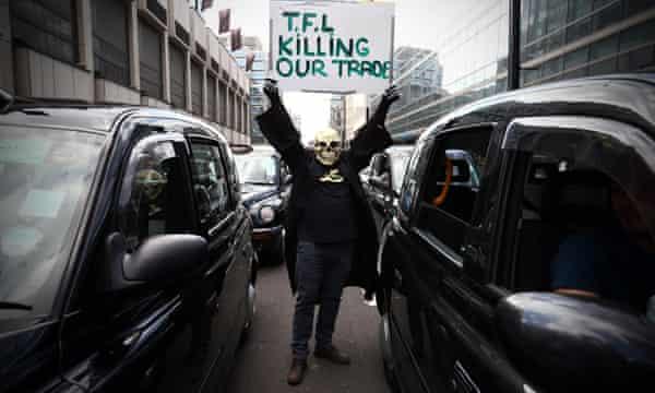 Masked demonstrator in black cab protest