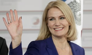 Helle Thorning-Schmidt waves and smiles in a blue jacket and understated necklace