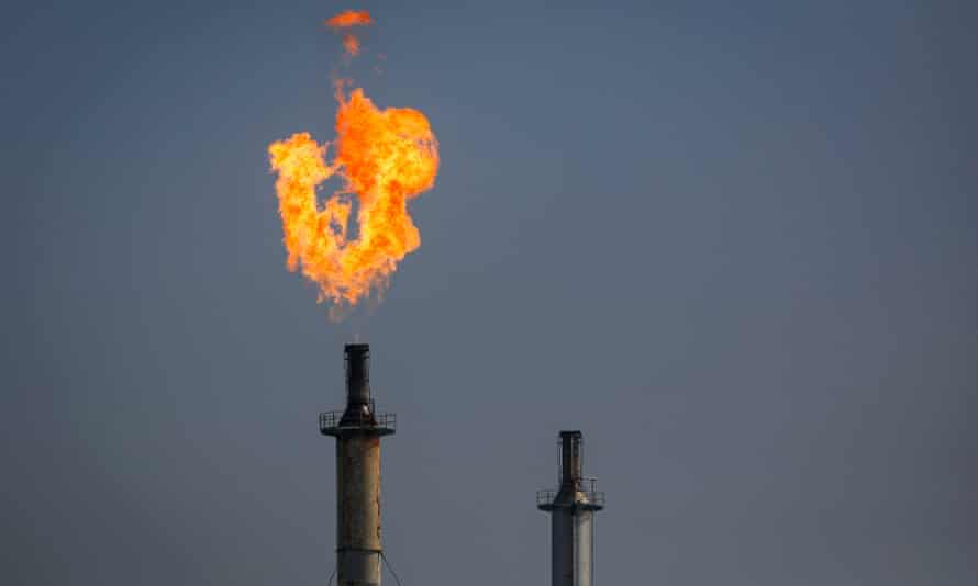 A flare burns over the ExxonMobil's refinery in Los Angeles, California.