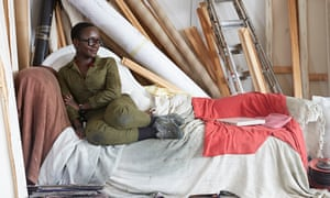 Artist Lynette Yiadom-Boakye in her cramped studio in Hackney, London.