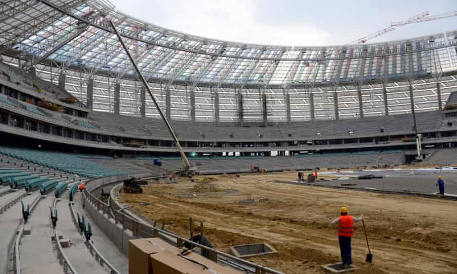Workers at the national stadium in Baku, soon to host the European games in June.