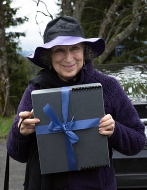 Margaret Atwood holding the manuscript for Scribbler Moon, for Future Library