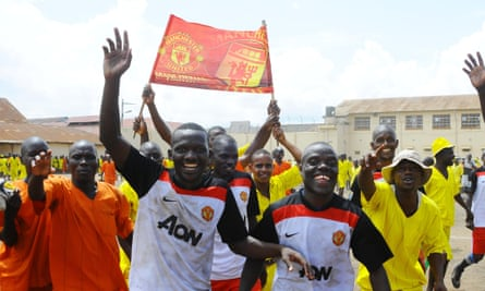 Manchester United members celebrate their 3-1 victory over Liverpool 3-1 in annual Radio Simba football tournament at Luzira maximum prison in Kampala.