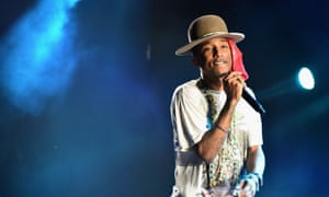 Pharrell Williams performs onstage in Philadelphia in one of his trademark hats
