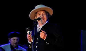 Bob Dylan in a fedora on stage at Hop Farm Festival in 2012