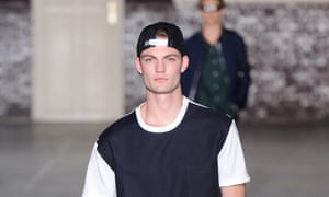 Baseball caps on the catwalk at Ami Alexandre Mattiussi's Spring/Summer 2015 show
