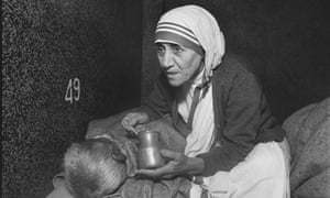 Mother Teresa caring for the dying in Kolkata, India, 1980.