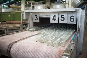 Once the bottles are made from the molten glass, they are put through a freezer to reduce their temperature from 400 degrees to around 45 degrees [SHOULD SWAP WITH PICTURE ABOVE]