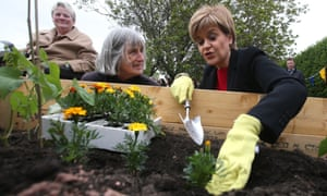 Nicola Sturgeon (right) visiting a gardening project at a housing association development in Craigmillar, Edinburgh.