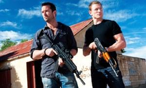Guns and poses: Scott and Stonebridge take a break from the mayhem.