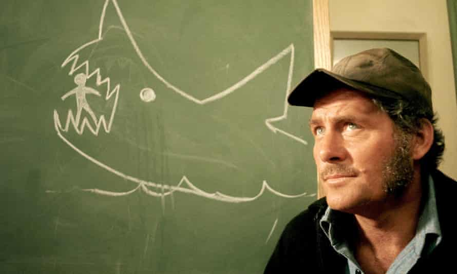 Robert Shaw as Quint, the fisherman who agrees to hunt down the shark, in Jaws.